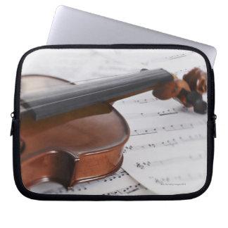 Violin and sheet music computer sleeves