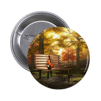 Violin in autumnal park buttons