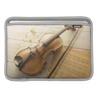 Violín y partitura funda  MacBook
