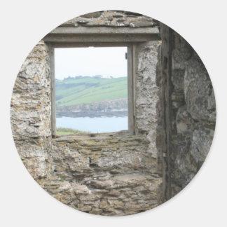 Visión desde la isla del municipio escocés hacia pegatina redonda