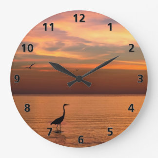 Vista al mar en la puesta del sol reloj redondo grande