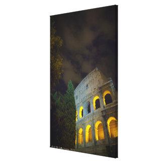 Vista del Coloseum en Roma en la noche Impresión En Lienzo