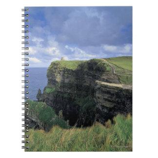 vista panorámica de un acantilado por la playa libro de apuntes