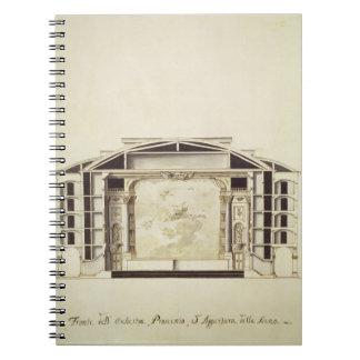Vista seccionada transversalmente de un teatro en  libro de apuntes con espiral