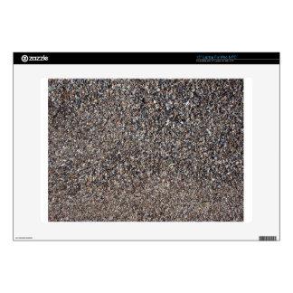 Vista superior de la arena mojada y de pequeñas calcomanías para 38,1cm portátiles