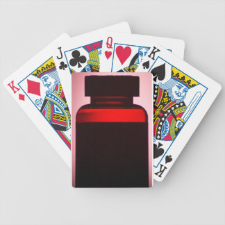 Vitamin pill bottle silhouette photograph bicycle playing cards