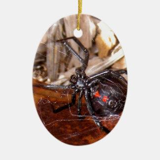 Viuda negra adorno navideño ovalado de cerámica