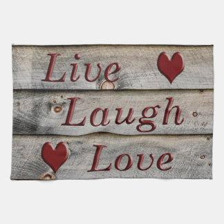 Vive el amor de la risa en el lado de un granero toalla de mano