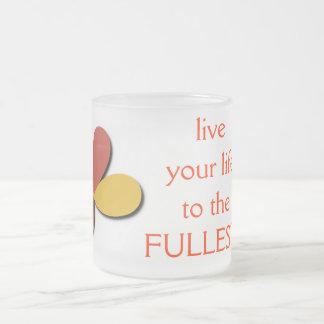 vive su vida al más lleno taza de café esmerilada