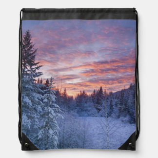 Vivid sunset paints the sky above wintery drawstring bag