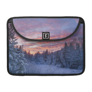 Vivid sunset paints the sky above wintery MacBook pro sleeve