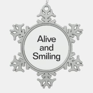 vivo y sonrisa adorno de peltre en forma de copo de nieve