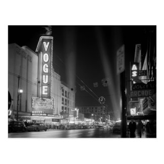 Vogue Theatre at night with spotlights Postcard