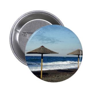 volcanic beach pinback button