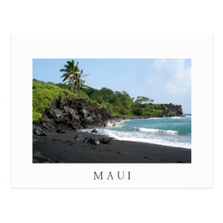 Volcanic black sand beach on Maui white postcard