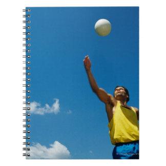 Voleibol de la porción del hombre cuadernos