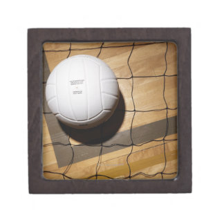 Volleyball and net on hardwood floor of jewelry box