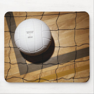 Volleyball and net on hardwood floor of mouse pad