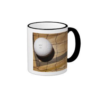 Volleyball and net on hardwood floor ringer mug