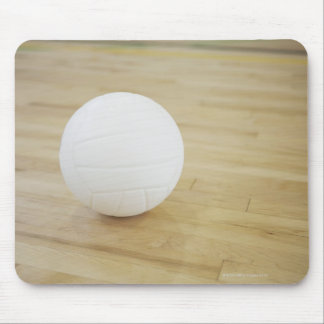 Volleyball on wooden floor mouse pad