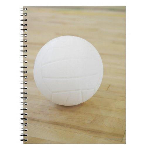 Volleyball on wooden floor notebook