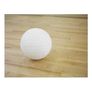 Volleyball on wooden floor postcard