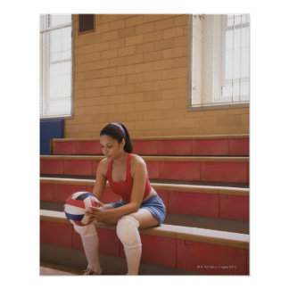 Volleyball player with volleyball poster