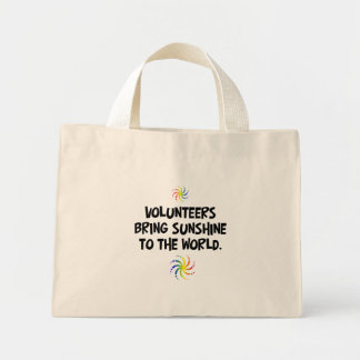 Volunteers bring sunshine to the world mini tote bag