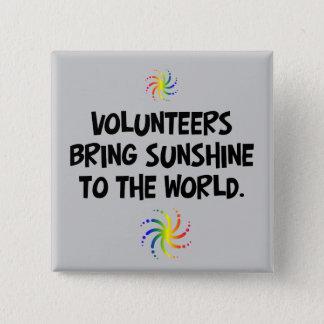 Volunteers bring sunshine to the world pinback button