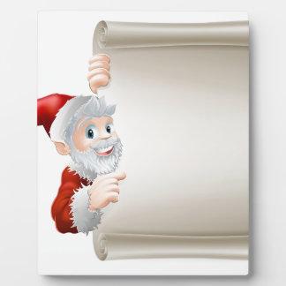 Voluta del navidad de Santa del dibujo animado Placa Para Mostrar