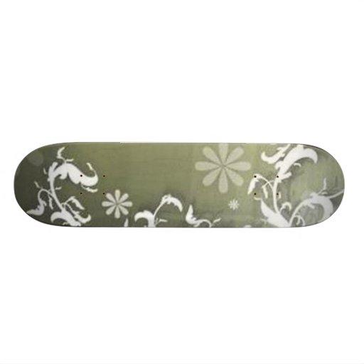 Volutas � flores sobre motivo verde - tablas de skate