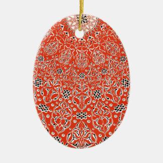 Volutas persas rojas de los remolinos del modelo adorno navideño ovalado de cerámica