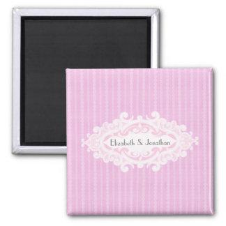 Volutas rosadas y el casarse de las cintas iman de nevera