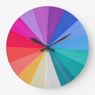 vortex of colours round large wall clock