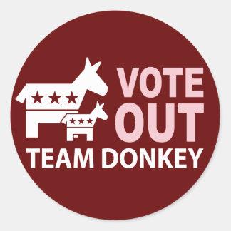 Vote hacia fuera el burro del equipo pegatina redonda