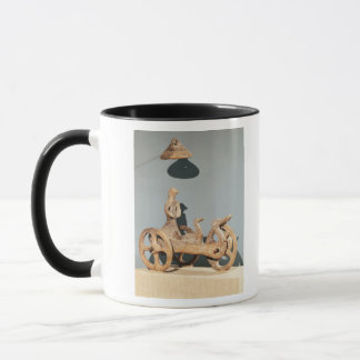 Votive chariot with an anthropomorphic divinity mug