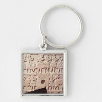 Votive plaque depicting an offering scene keychain