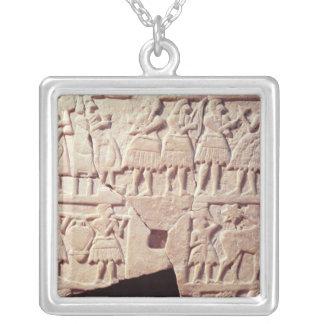Votive plaque depicting an offering scene square pendant necklace