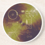 """Voyager 1 and 2 Golden Record Sounds of Earth Coaster<br><div class=""""desc"""">This gold aluminium cover was designed to protect the Voyager 1 and 2 &quot;Sounds of Earth&quot; gold-plated records from micrometeorite bombardment, but also serves a double purpose in providing the finder a key to playing the record. The explanatory diagram appears on both the inner and outer surfaces of the cover,...</div>"""