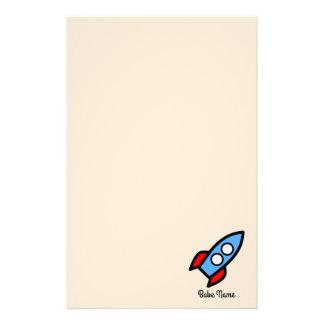 Vuelo azul del cohete papeleria de diseño