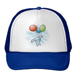 Vuelo azul lindo del conejito con los globos gorro
