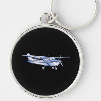 Vuelo clásico de la silueta de Cessna de los Llavero Redondo Plateado