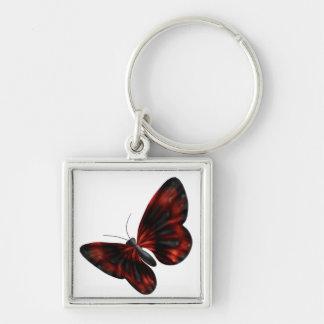 Vuelo con alas rojo sangre y negro de la mariposa llavero