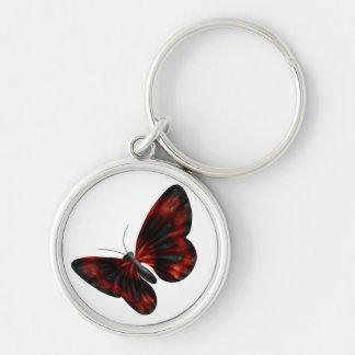 Vuelo con alas rojo sangre y negro de la mariposa llavero redondo plateado