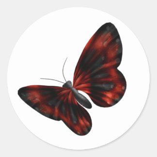 Vuelo con alas rojo sangre y negro de la mariposa pegatina redonda