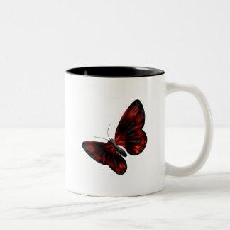 Vuelo con alas rojo sangre y negro de la mariposa taza de dos tonos