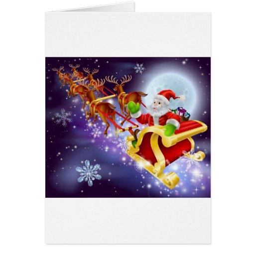 Vuelo de Santa del navidad en su trineo o trineo Felicitaciones