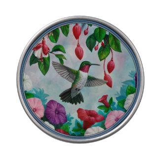 Vuelo del colibrí en jardín de flores latas de dulces