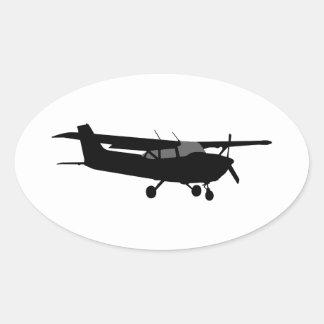Vuelo negro clásico de la silueta de Cessna de los Pegatina Ovalada