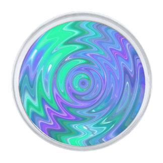 Vuelta del extracto del verde azul insignia plateada